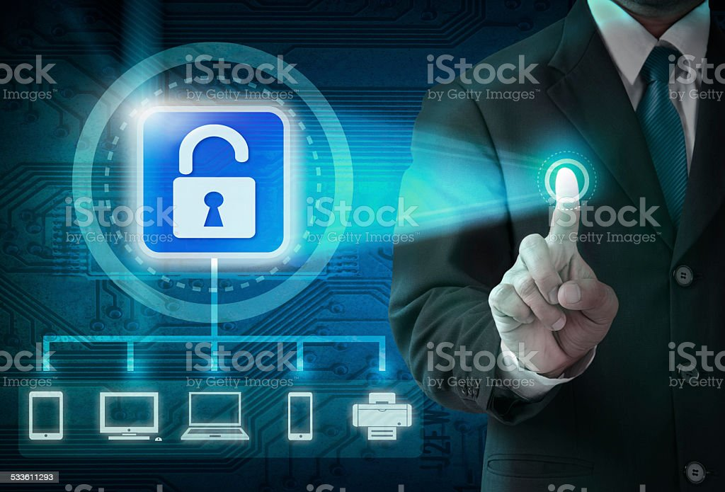 Hand pushing virtual security button on digital background stock photo