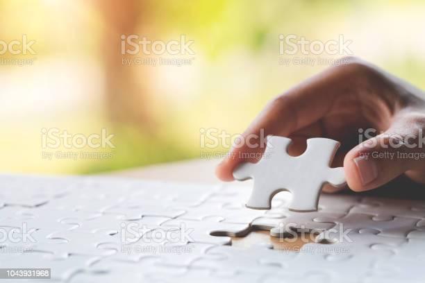 Hand put the last piece of jigsaw puzzle to complete the mission picture id1043931968?b=1&k=6&m=1043931968&s=612x612&h=qulko1 pw3cfok0jqrvndwzwijtm3tzdpgbfofxspas=