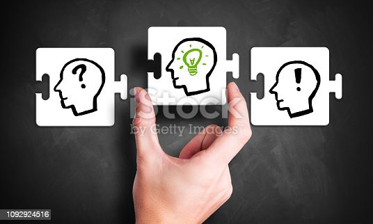 istock hand puts the missing piece of the idea puzzle 1092924516