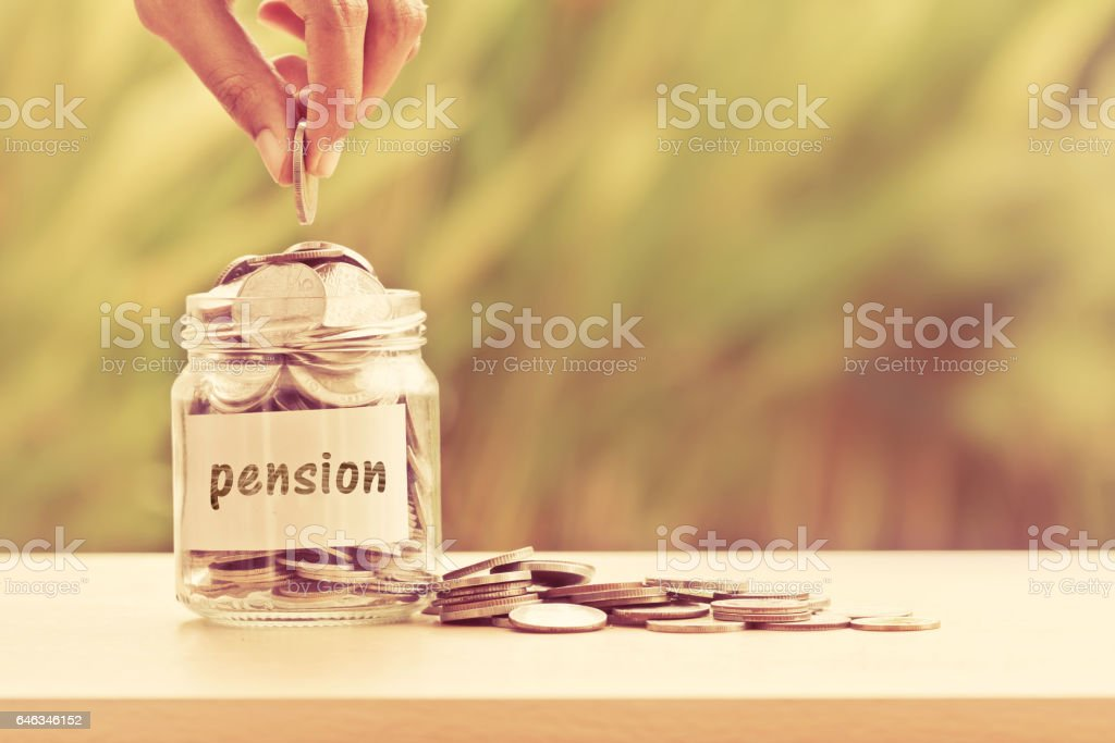 Hand putting Coins in glass jar   for pension – Foto