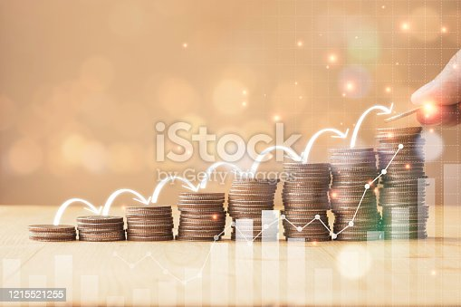 Hand putting coins stacking with infographic arrow jump step for growth business and saving investment concept.