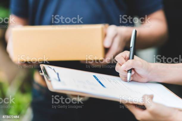Hand putting signature in clipboard to receive package from delivery picture id873472484?b=1&k=6&m=873472484&s=612x612&h=sljekvx0tdbclelppdz5otenfvn5o5dyibleljrwv9g=