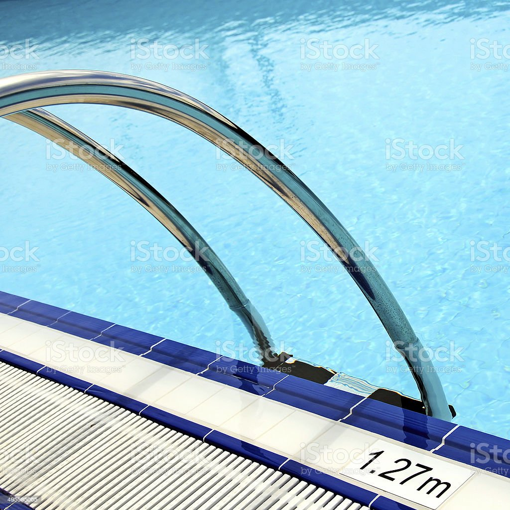 hand rails at poolside stock photo