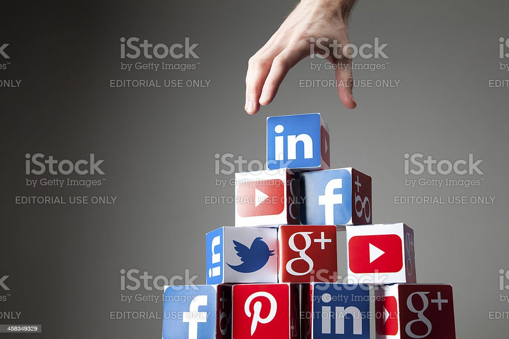 Hand reaching for social media icons stock photo