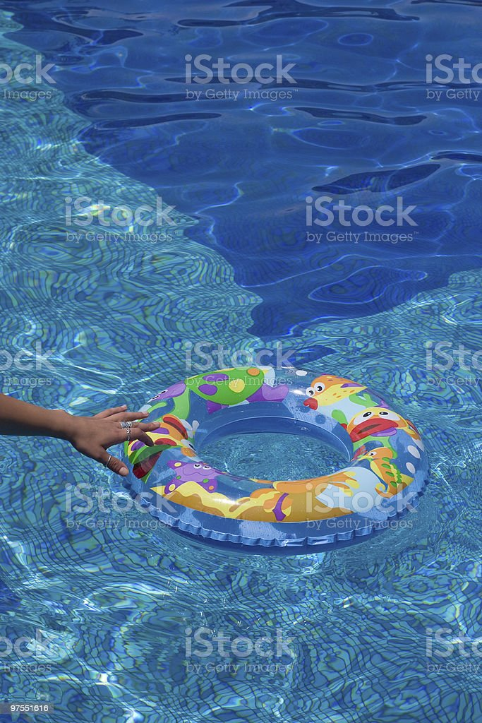 Hand reaching for the rubber swimming ring royalty-free stock photo
