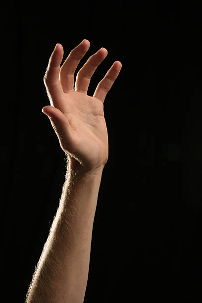 Hand Reaching Up For Help stock photo