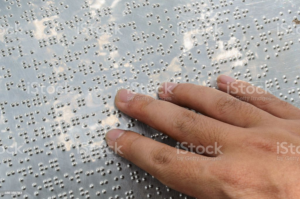 Hand reading braille stock photo