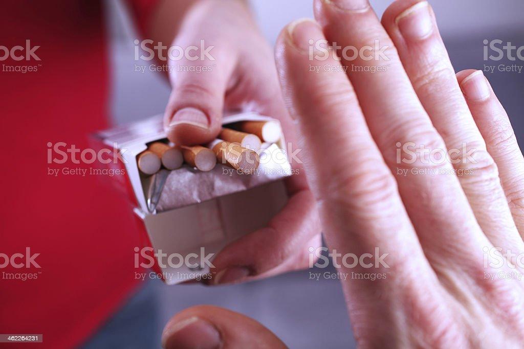 Hand refusing cigarette stock photo