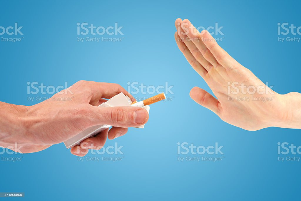 hand reject a cigarette offer stock photo