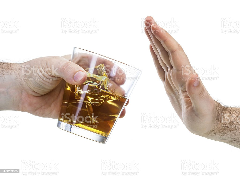 hand reject a glass of whisky stock photo