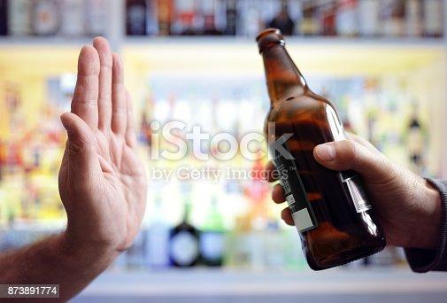 istock Hand rejecting alcoholic beer beverage 873891774