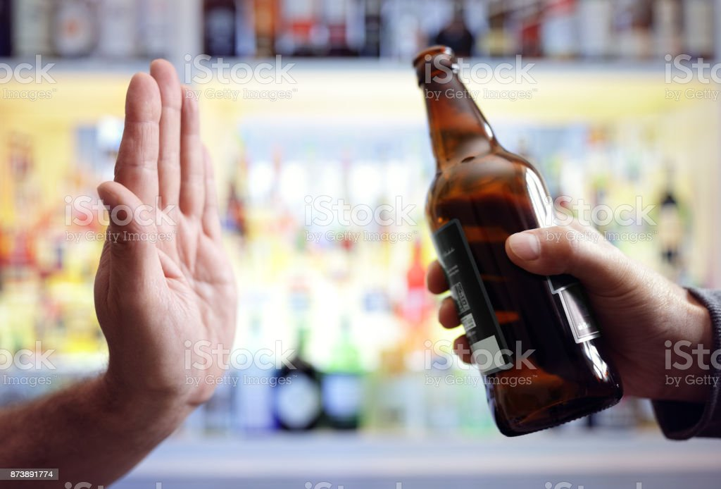 Hand rejecting alcoholic beer beverage stock photo