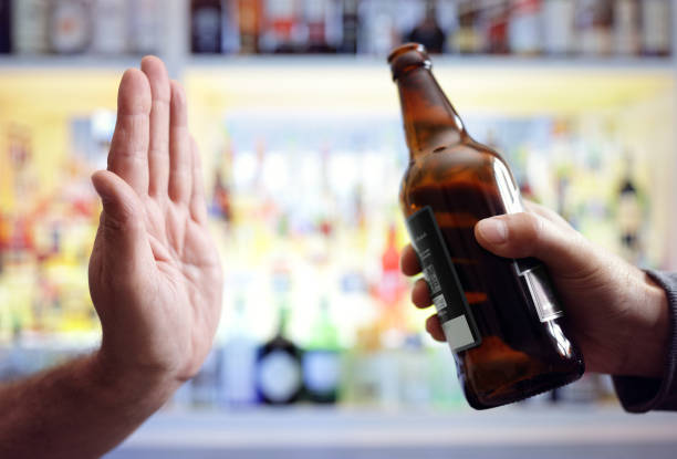 Hand rejecting alcoholic beer beverage - foto stock