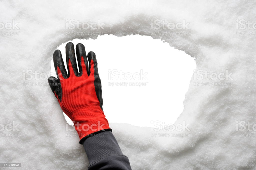 Hand removing a frozen snow from window against white background stock photo