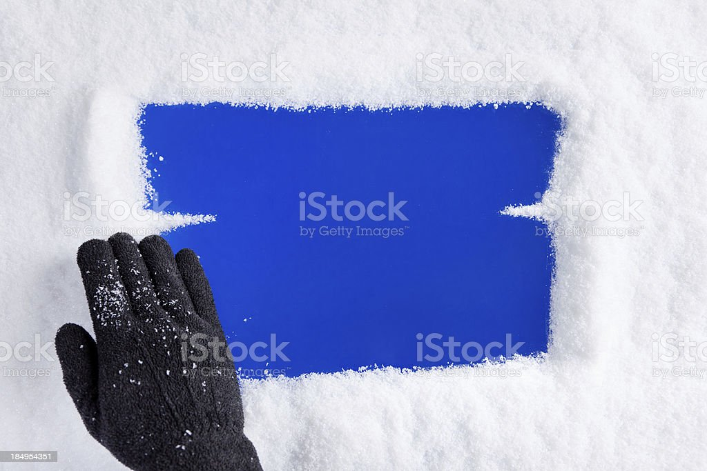 Hand Removing Snow From Window stock photo