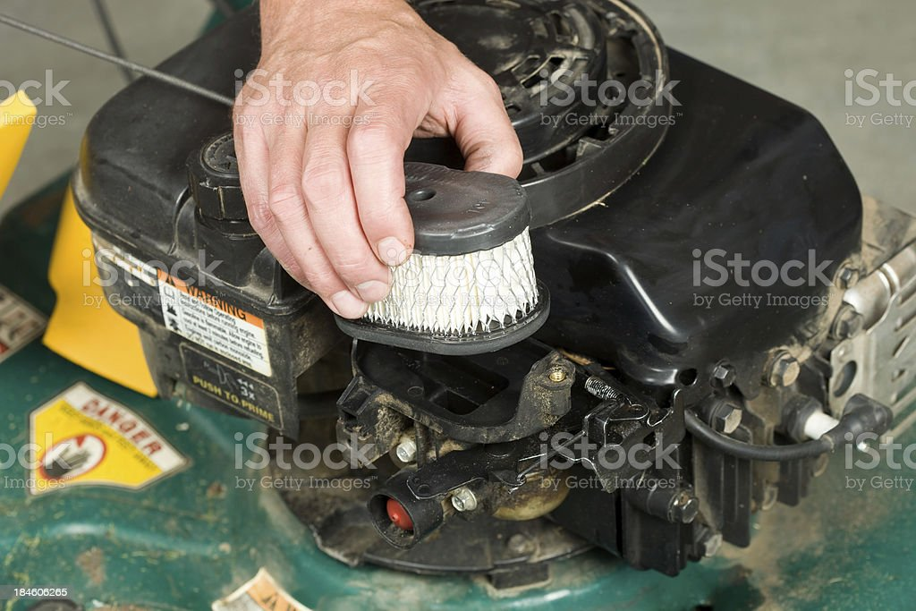 Hand Replacing Lawnmower Air Cleaner royalty-free stock photo