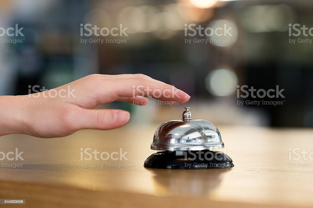 Hand ring bell at hotel stock photo