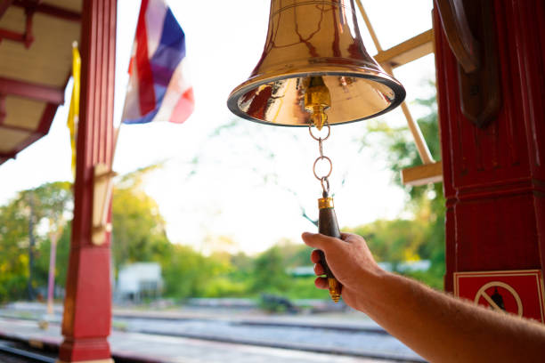 hand rings the bell. male hand is ringing the bell - squillare foto e immagini stock