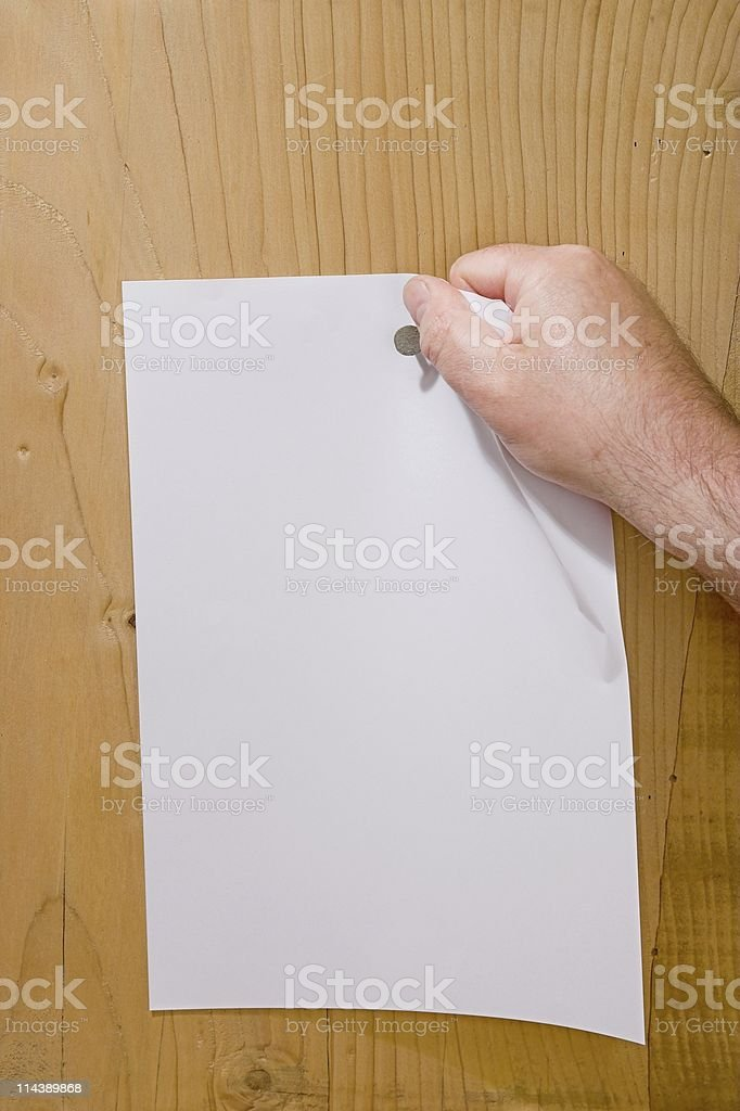 Hand Ripping Down Blank Notice royalty-free stock photo