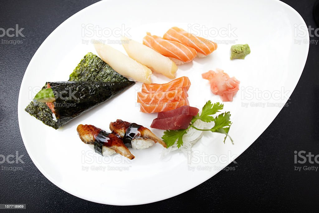 Hand roll and variety of sashimi on plate royalty-free stock photo