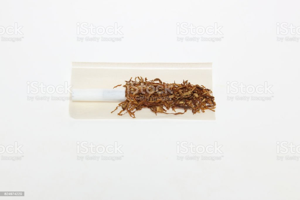 Hand rolled cigarettes stock photo