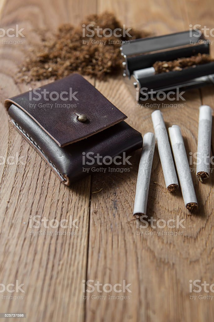 hand rolling cigarettes stock photo