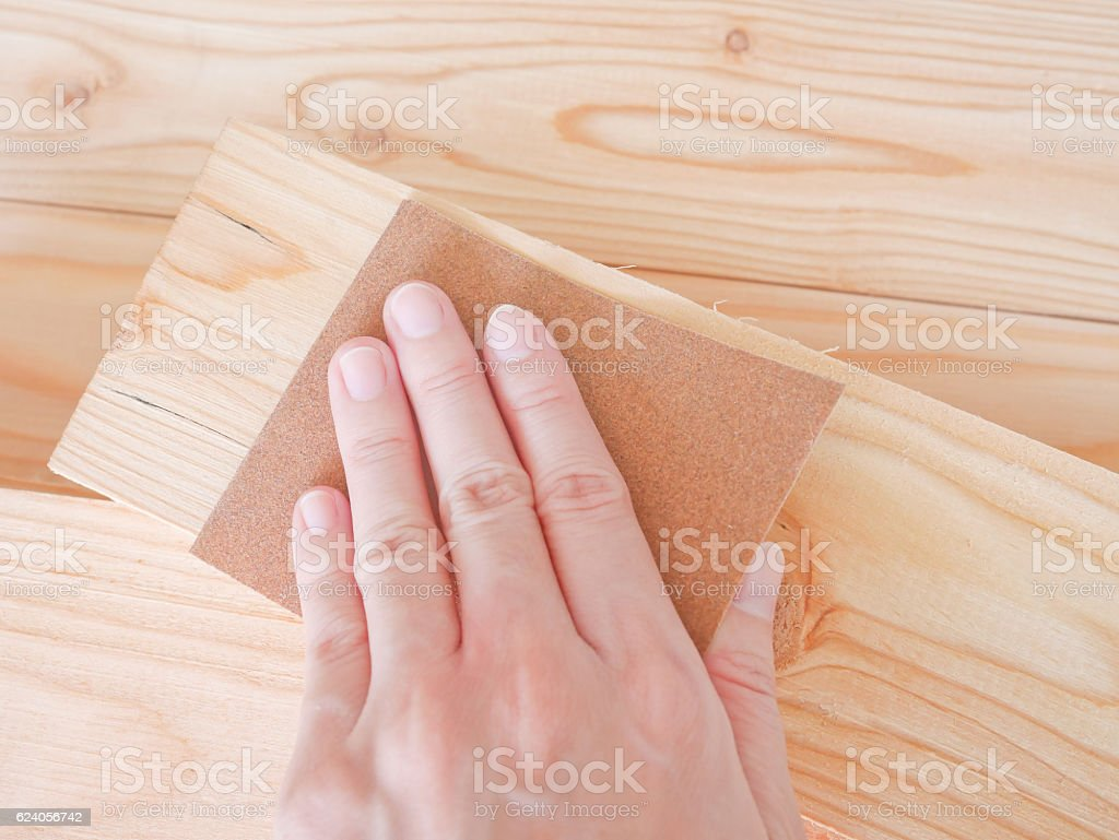 Hand sanding wooden pallet stock photo