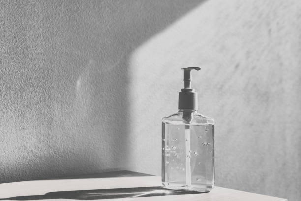 Hand sanitizer alcohol gel rub bottle shortage supply at stores for Corona virus panic coronavirus prevention washing hands bottle dispenser at home or hospital background stock photo
