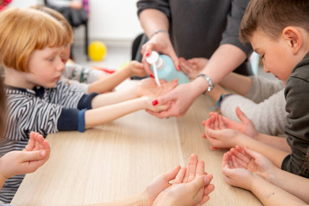 Hand Sanitizer used to protect kids in Primary School stock photo