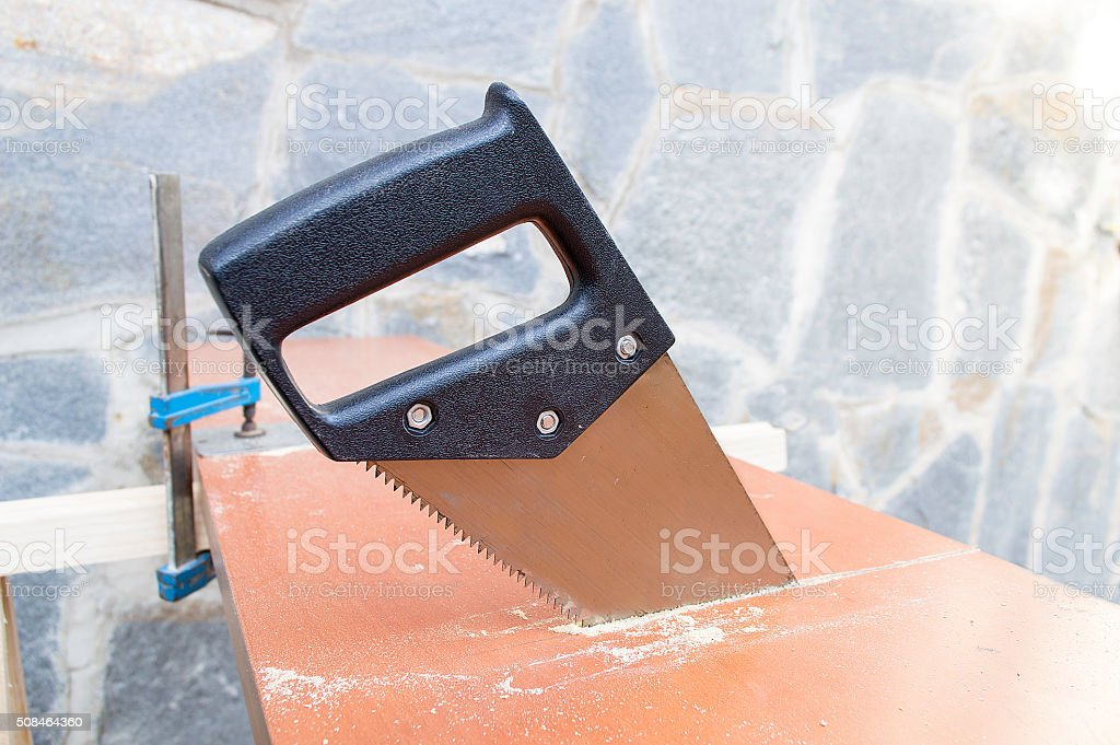 close up of hand saw isolated