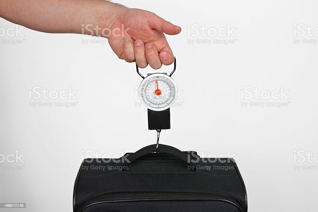 Hand Scale for Measuring Luggage Weight stock photo