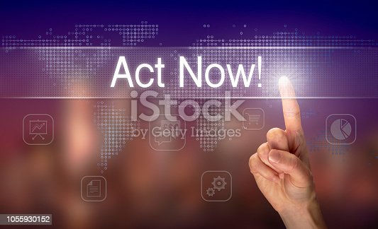 A hand selecting an Act Now business concept on a clear screen with a colorful blurred background.