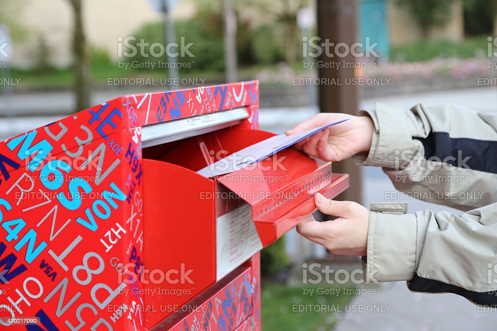 Hand sending a tax report letter stock photo