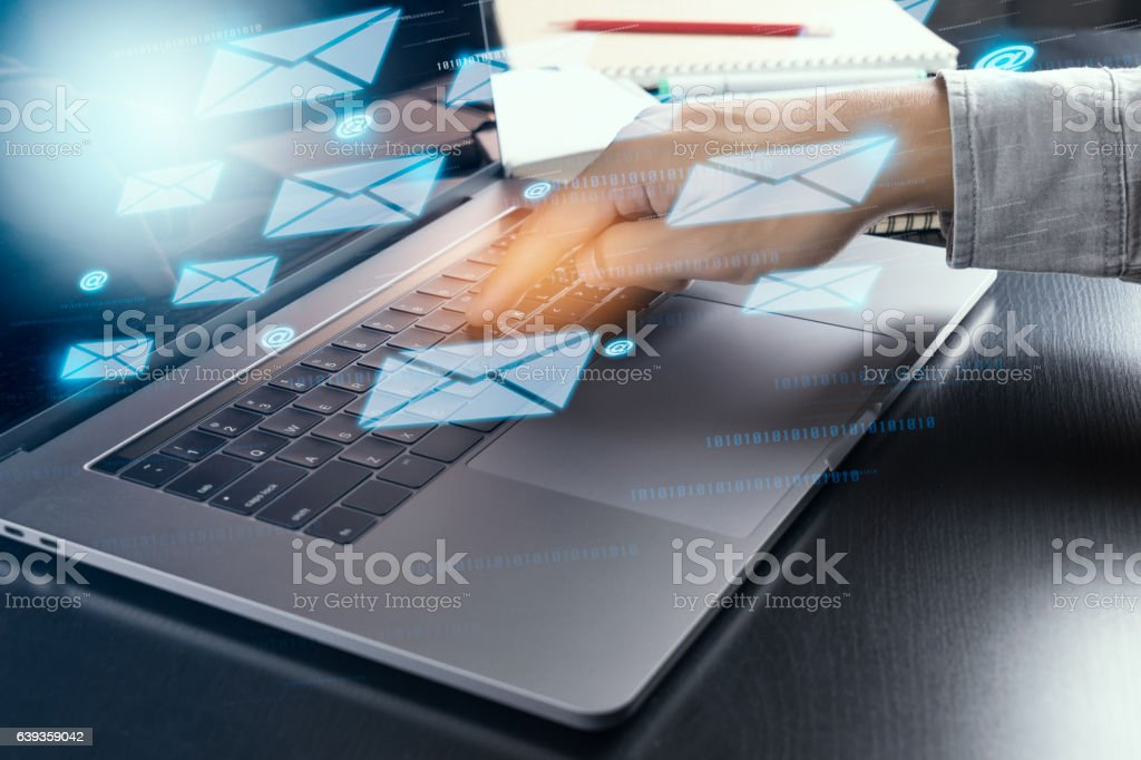 hand sending electric mail from modern laptop computer stock photo