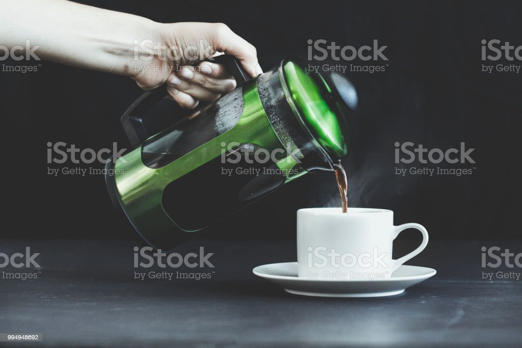 A hand serving coffee stock photo