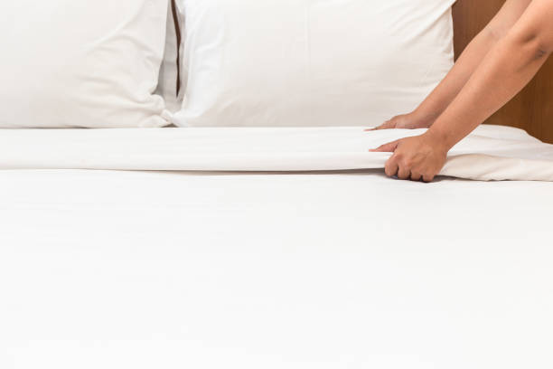 hand set up white bed sheet in hotel room - making stock pictures, royalty-free photos & images