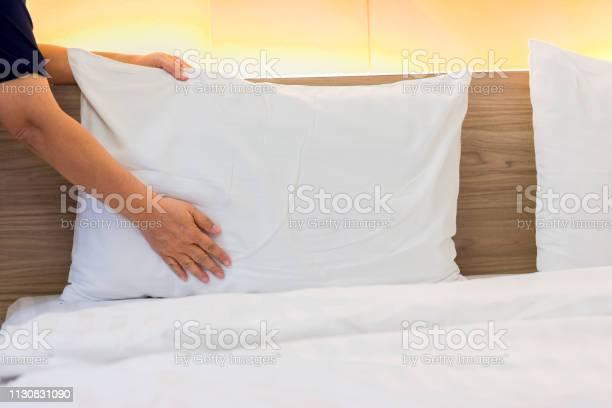 Hand set up white pillow on bed sheet picture id1130831090?b=1&k=6&m=1130831090&s=612x612&h=c g1khr3gcxma3vaookzytryuberzquv74aiq0jjv5o=