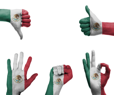 A set of hands with different gestures wrapped in the flag of Mexico