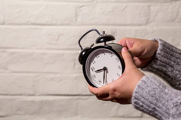 Best Setting Alarm Stock Photos, Pictures & Royalty-Free Images - iStock