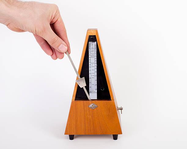 Hand Setting Metronome stock photo