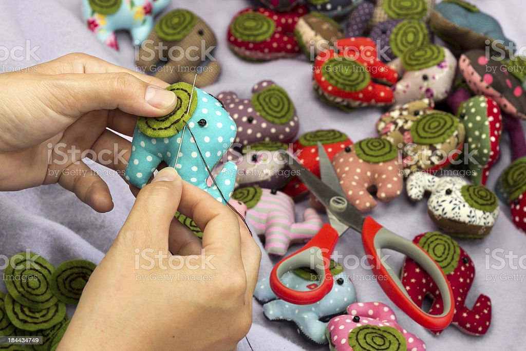 Hand sewing and elephant cloth dolls stock photo