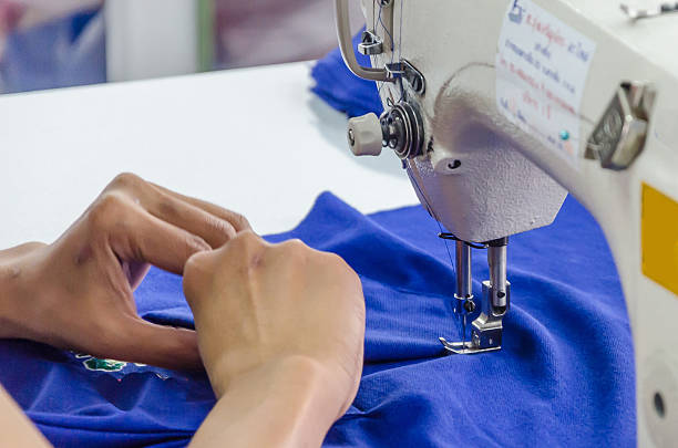 hand sewing on a machine - embroidery machine stock pictures, royalty-free photos & images