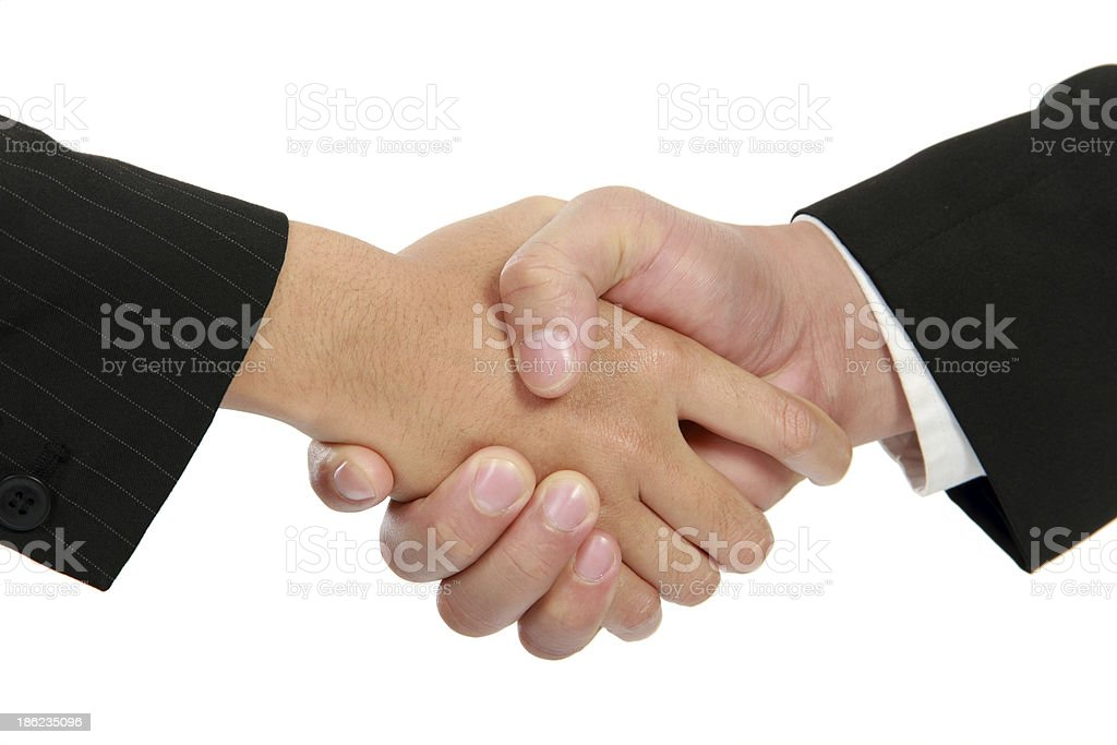 Hand shake between businessman and businesswoman royalty-free stock photo