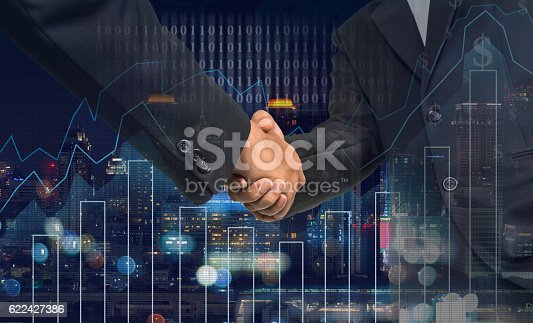 istock Hand shake between businessman on Trading graph on the cityscape 622427386