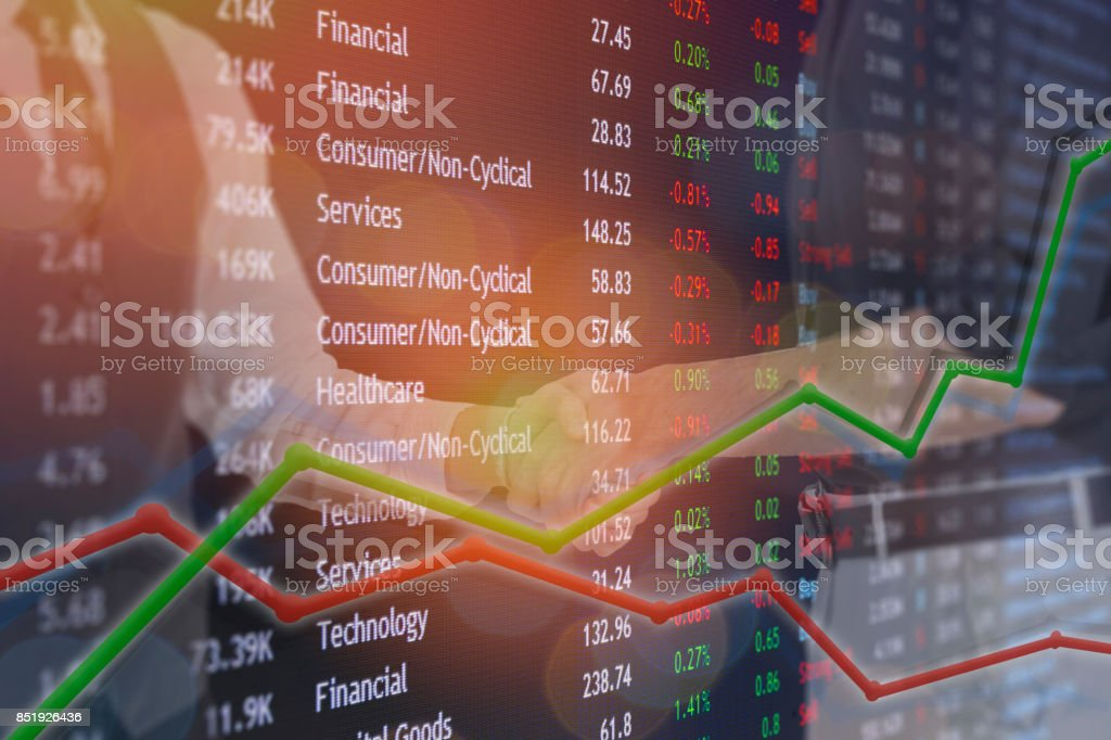 Hand shake business deal for exchange bitcoin and stock market concept for deal to be made. stock photo