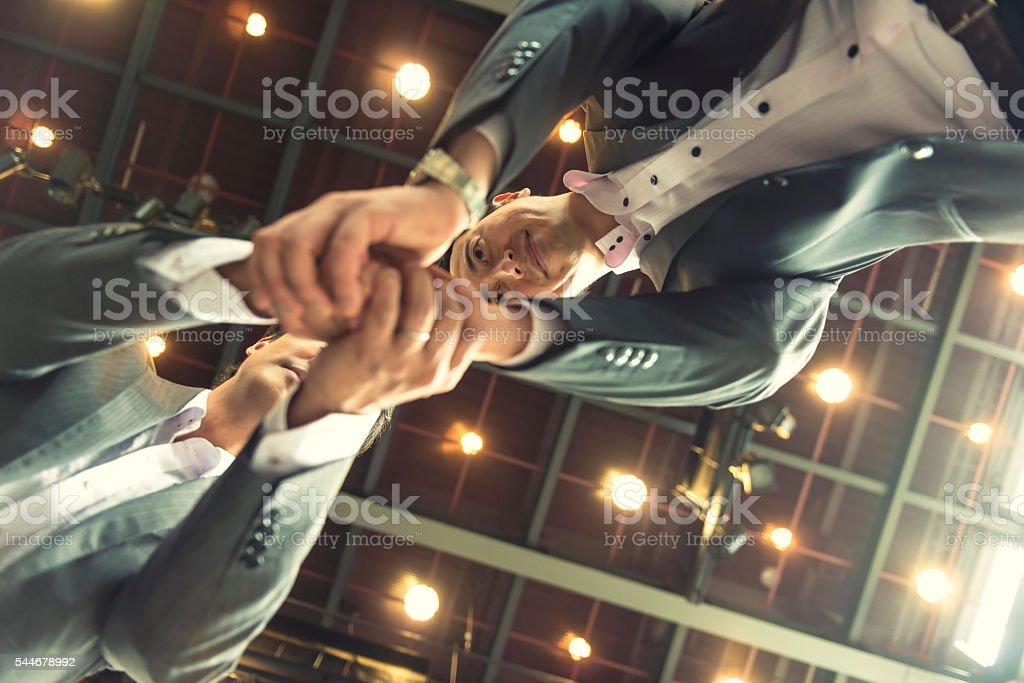 Hand shake of two Japanese businessman stock photo
