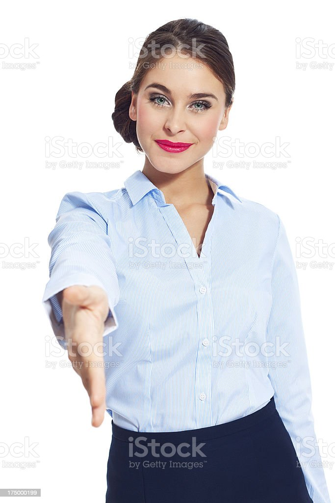 Hand shake Portrait of attractive businesswoman standing against white background and ofering handshake. 20-24 Years Stock Photo