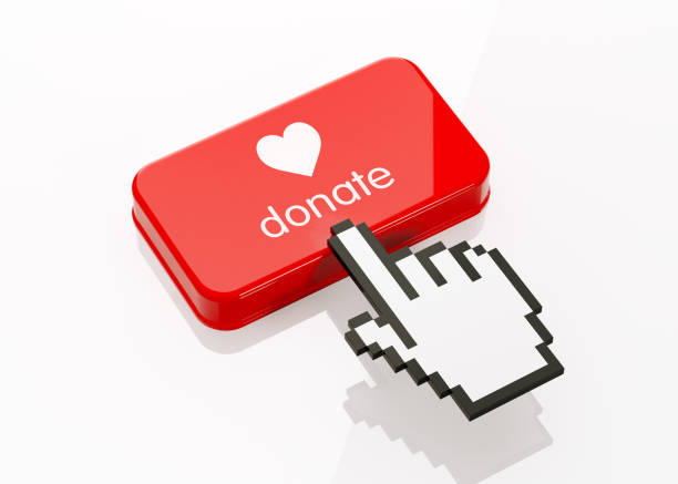 Hand Shaped Computer Cursor Clicking On A Red Button: Donate Writes On Button stock photo