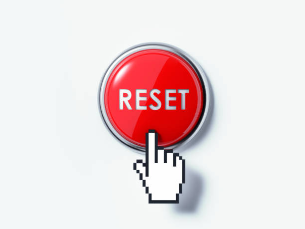 Hand Shaped Computer Cursor Clicking On A Red Push Button Hand shaped computer cursor is clicking on a red computer button on white reflective surface. Reset writes on the push button. Horizontal composition with copy space and clipping path. push button stock pictures, royalty-free photos & images