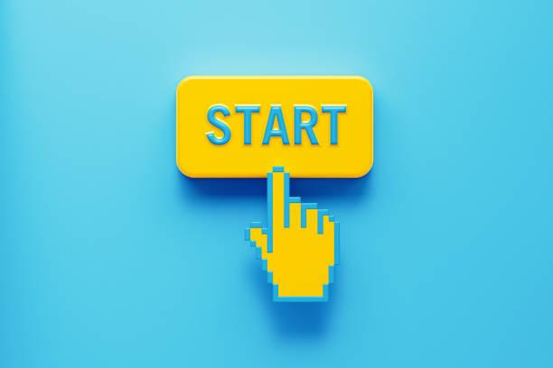 handgeformter computercursor klick über einen gelben druckknopf: start geschrieben auf druckknopf - anfang stock-fotos und bilder